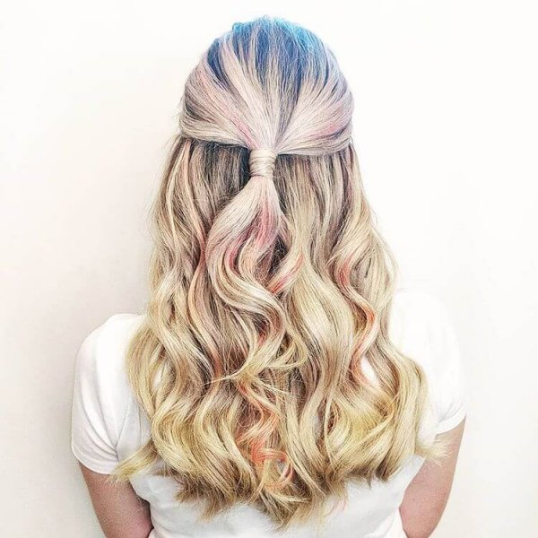 blond with streaks of pink slavic and russian hair extensions styled