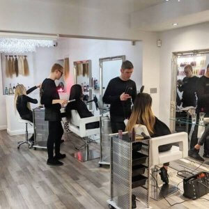 hair technicians and clients in salon
