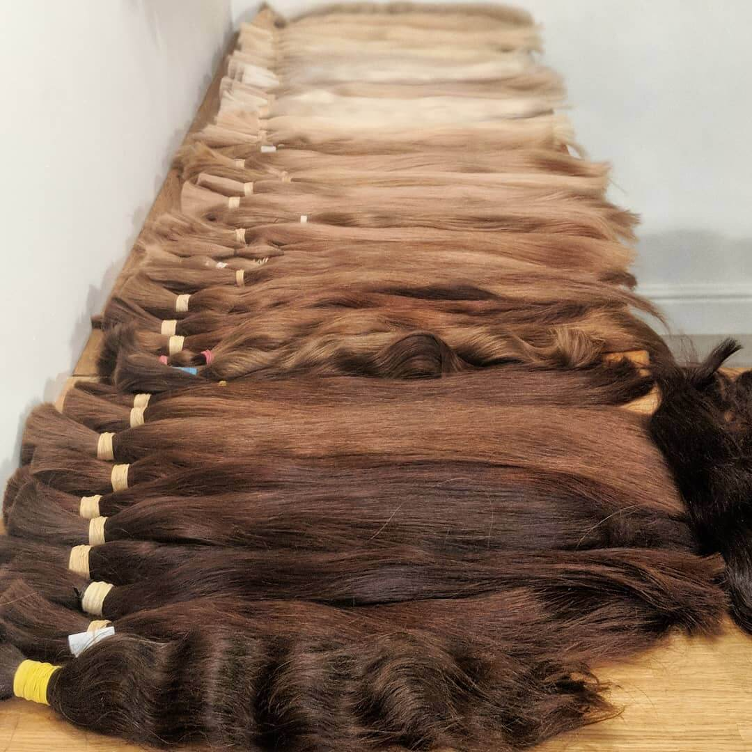 dark to light russian hair wefts laid out on table
